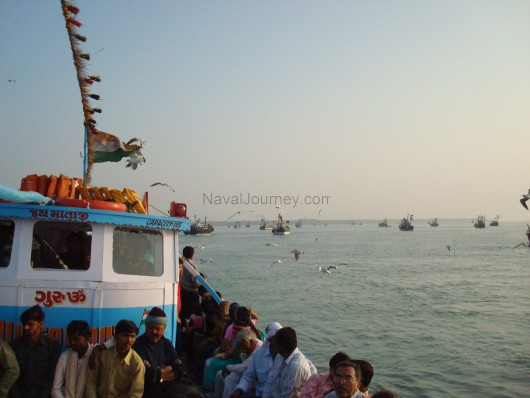 A FERRY CARRYING PASSENGERS